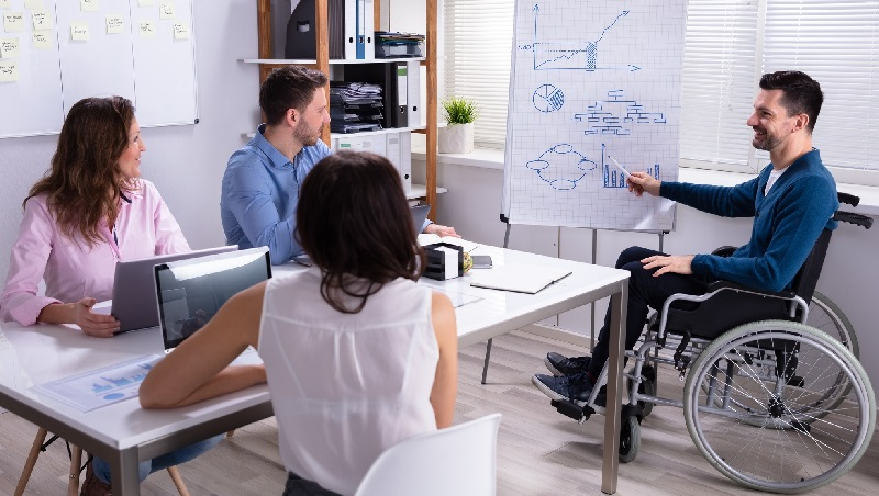 Man in wheelchair giving a presentation