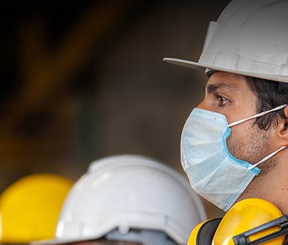 Construction worker wearing a mask